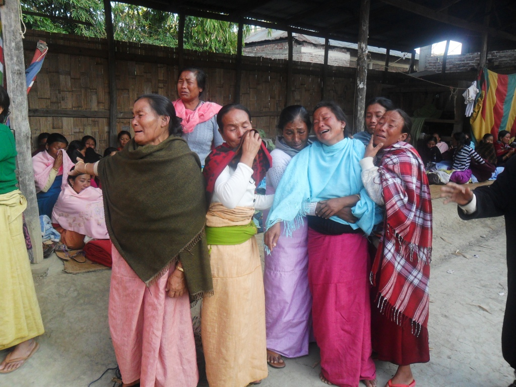Displaced women after the arsoning of floating huts by Loktak Lake