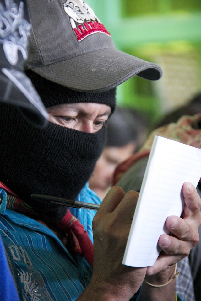 A man takes notes during the Tata Juan Chávez Alonso Seminar about indigenous struggles, which began directly the Zapatistas first school on liberty earlier this month. (WNV/Marta Molina)
