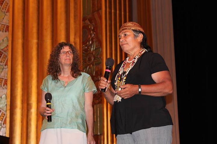Caleen Sisk, Chief of the Winnemem Wintu Tribe, speaks against the raising of Shasta Dam as Jessica Abbe, writer for the On Sacred Ground series, listens at the premiere showing of Episode 1: Pilgrims and Tourists, at the Cascade Theatre in Redding on Sept 14.