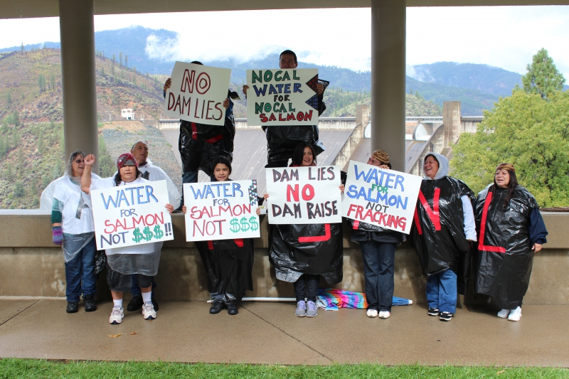 The Winnemem Wintu Tribe protests plans to raise Shasta Dam and to build the twin tunnels during a break in the rain. Photo by Dan Bacher.
