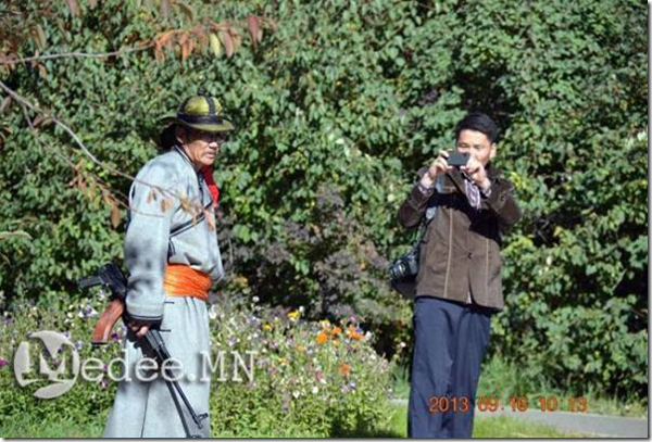 Ms. Gantulga (with camera) of UMMRL was arrested twice since 16 September 2013 for photographing public events and protests like the 16 September 2013 protest.
