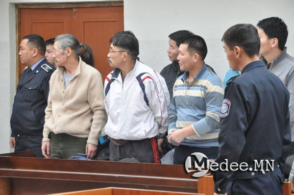 The six environmental leaders accepted their sentences in court with dignity and calm.  Ts. Munkhbayar is the 4th from left, front row.  Photo 21 January 2014.