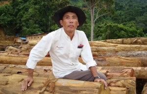 Numpang Suntai and illegally felled logs from his community lands in Sebangan