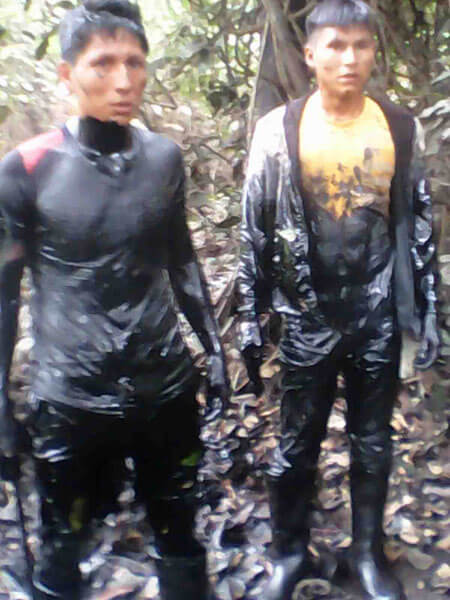 Local men were covered with oil after being hired to find the leak in the submerged pipeline. (Photo: Municipality of Urarinas)
