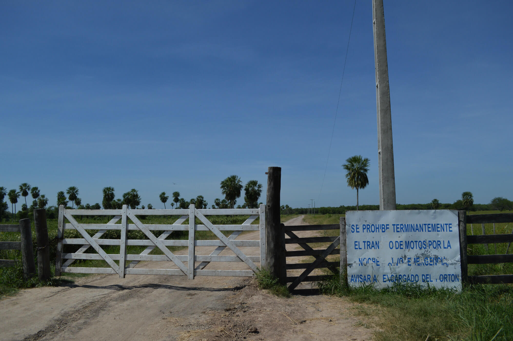 The beginning of the 80km road through cattle ranch estates leading to Yexwase Yet. The sign says 'travel on the road after dark is prohibited'. (Photo credit: Fionuala Cregan)