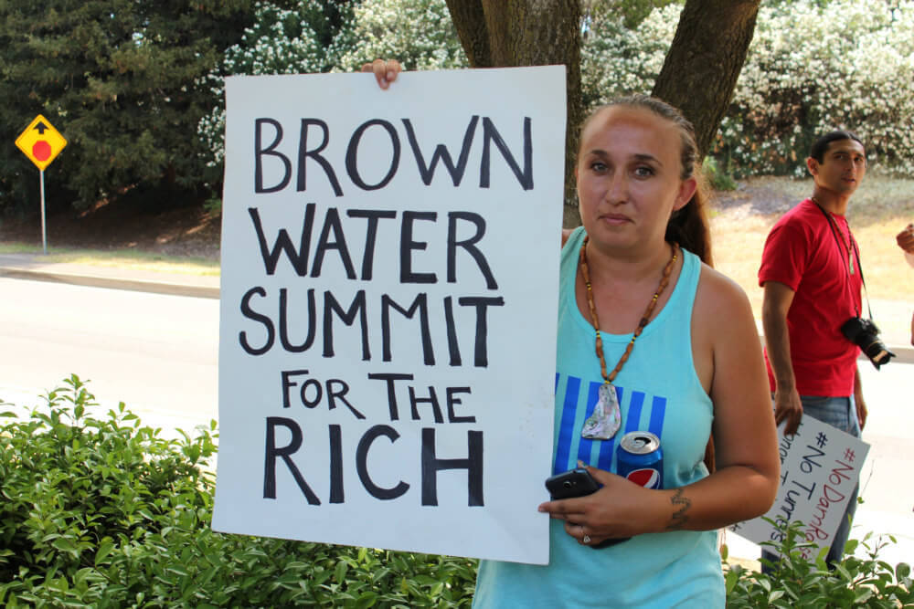 Jessica Lopez, Vice Chair of the Concow Maidu Tribe, lets Governor Brown know how she feels about the California Water Summit. Photo by Dan Bacher.