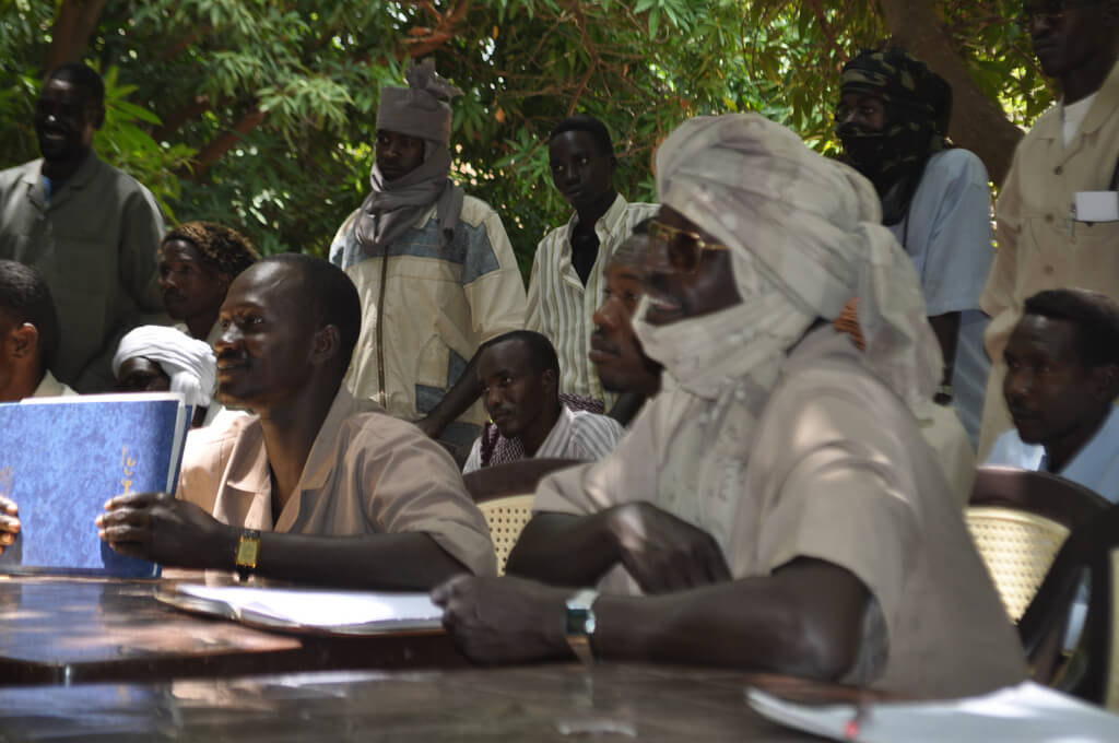Former JEM leader Khalil Ibrahim sits on the right (deceased), in Ain Siro, North Darfur, Sept 12, 2009. (Photo by the US  State Department)