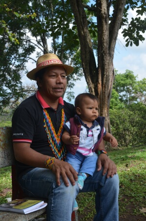 Feliciano Valencia with the baby who he had been separated from for 54 days while held in a maximum security prison. Robin Llewellyn