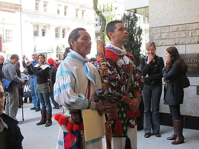 Jesús Lara Chivarra and Cilau Valadez face the entrance to First Majestic Silver Corp. headquarters in Vancouver, demanding entrance to the annual stockholders meeting.