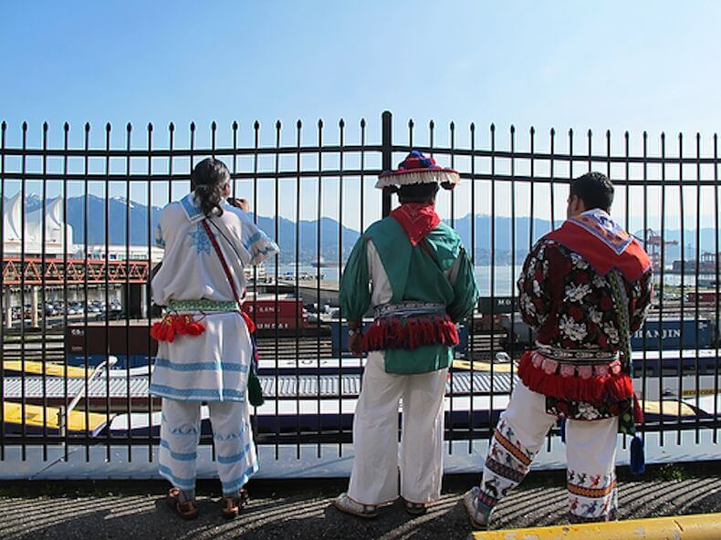 Members of the Wixarika delegation look out at the harbor in Vancouver after their meeting with First Majestic.