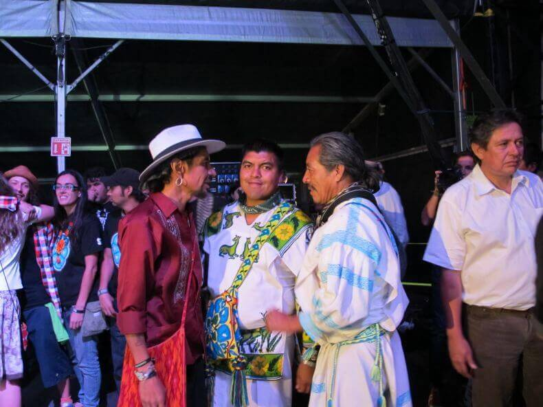 Jesus Lara Chivarra and Santos de la Cruz visit with Roco of the rock group Maldita Vecindad after Wirikuta Fest, which drew more than 60,000 fans and raised millions of pesos for the cause.
