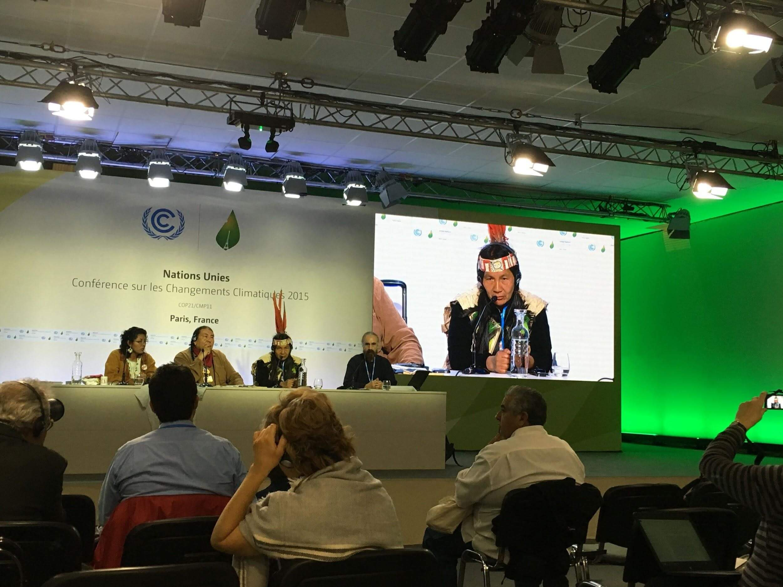 Tom Goldtooth of IEN and other Indigenous leaders speak at a COP21 press conference. Photo by Roopali Phadke