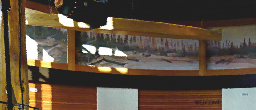 Canoe and murals in the Lummi Administrative Building