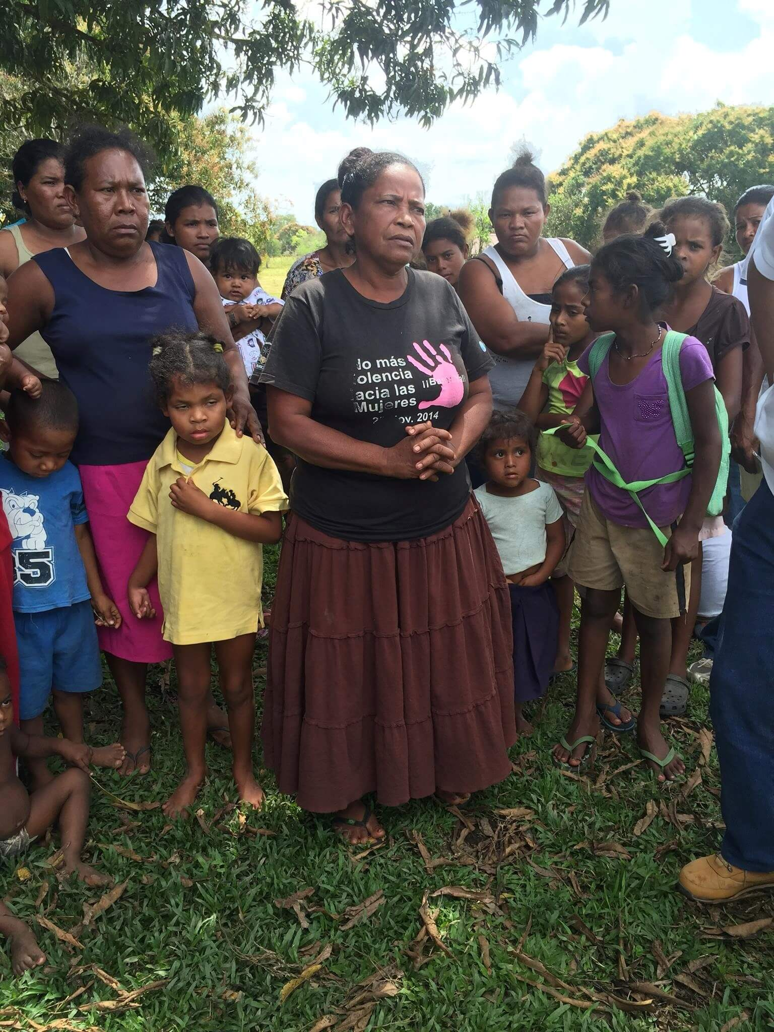 Surrounded by community members, a Miskito woman stands with her daughter – in the yellow shirt – who was shot in the head by a 'colonos'. Photo: Courtney Parker, Intercontinental Cry, 2016