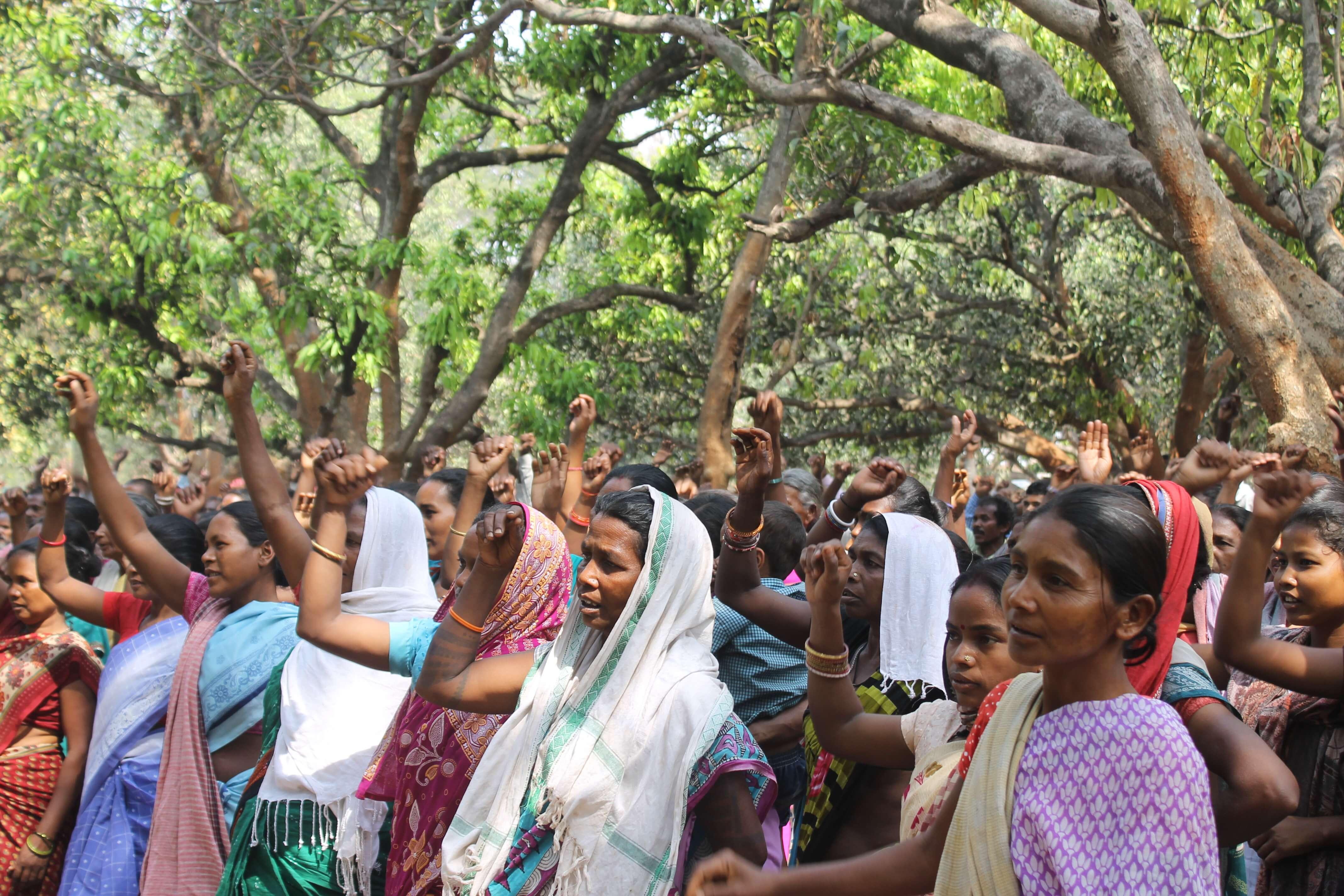 women raising slogans