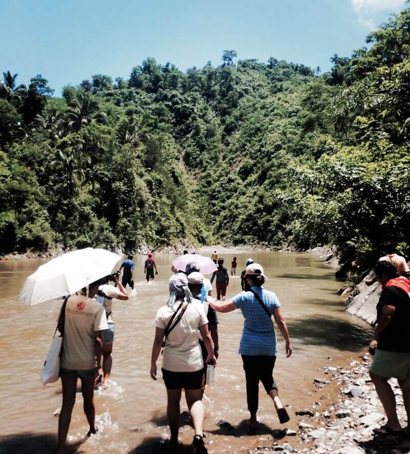 Delegates of the International Solidarity Mission fording the Jalaur River.
