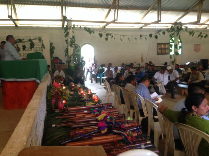 Dozens of staff lay on the table showing that many ancestral authorities are attending the general assembly in Copones. Photo: Manuela Picq