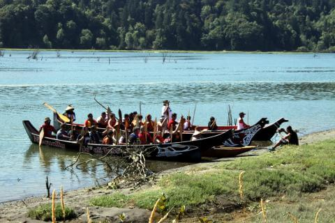 Tribal communities are greeted upon arrival at the 2016 Paddle to Nisqually. Photo by G.H. Thorn