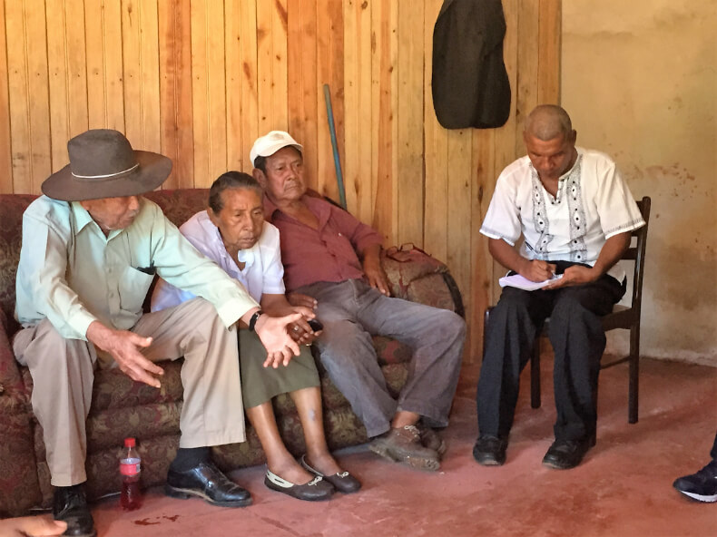 Members of the Miskitu Council of Elders, and secretary Rosman Flores, gather in Bilwi to discuss their list of demands from the YATAMA political party in a private meeting preceding the YATAMA conference in February of 2016. Photo by Courtney Parker.