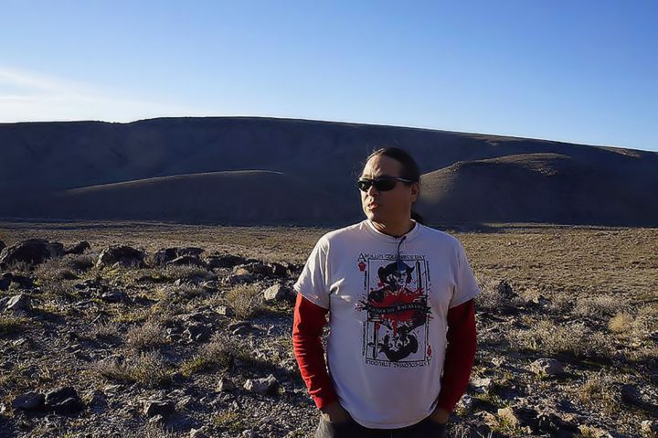 standing at the base of Yucca Mountain